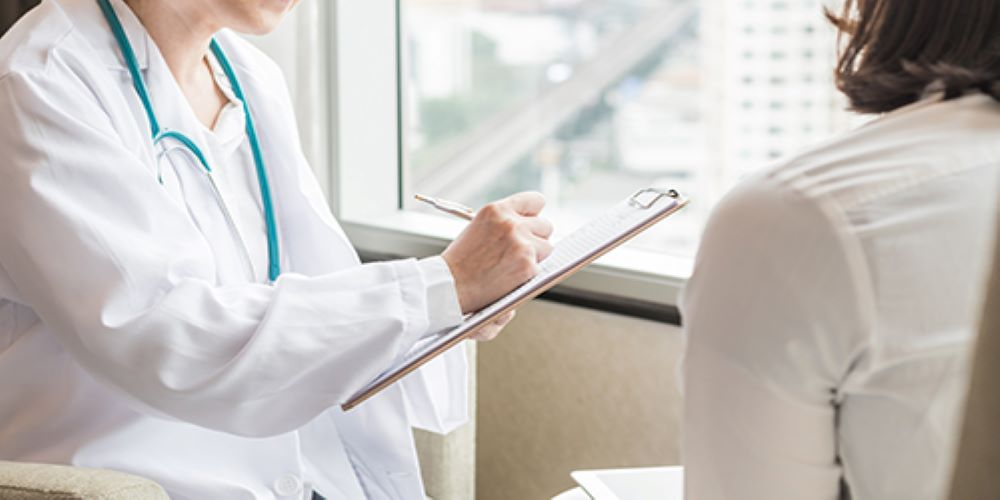 woman consulting a gynecologist