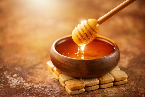 honey in a small wooden bowl