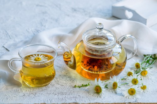 Chamomile Tea in a class cup and tea-pot