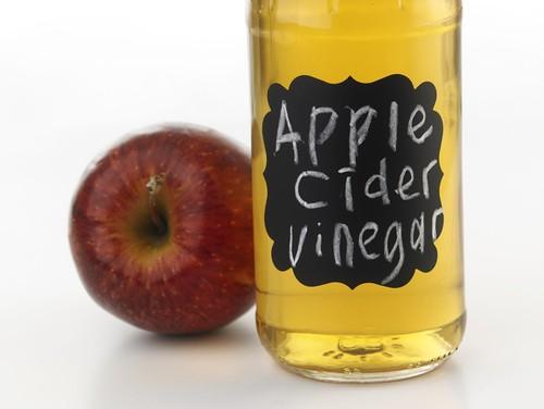 apple cider vinegar in a glass bottle