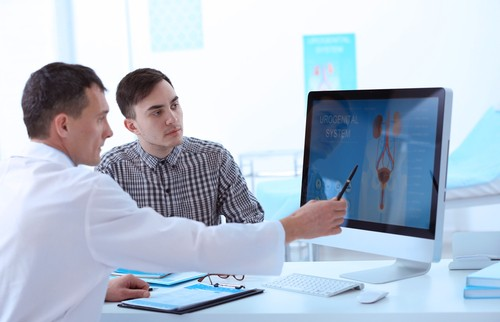 man consulting a urologist