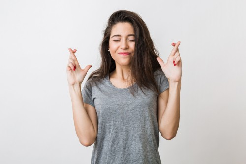 woman with crosses fingers