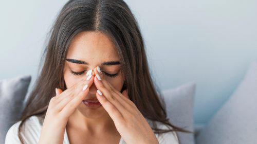 woman having pain due to sinus