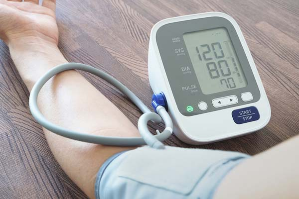 A blood pressure machine showing normal blood pressure
