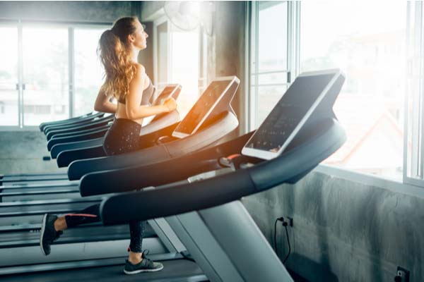 Girl running on the treadmill