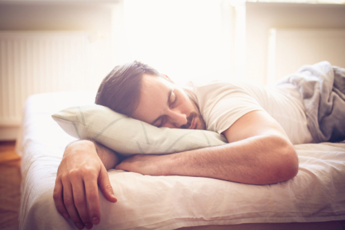 young man sleeping well in his bed