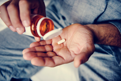 man taking health supplements