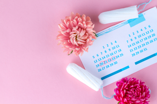 calendar and tampons kept on a pink background