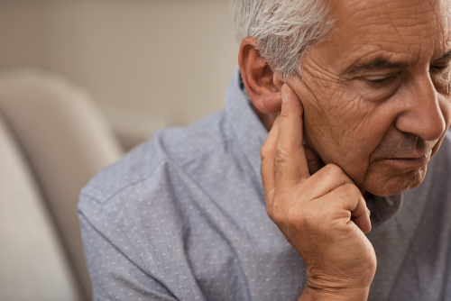 old man with hearing disability