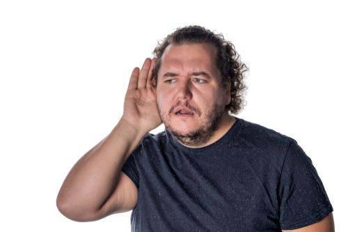 man having trouble hearing