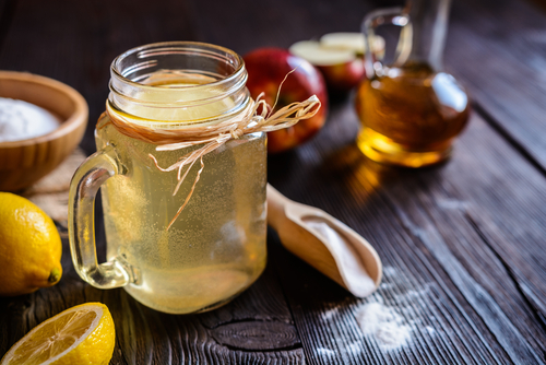 apple cider vinegar diluted in a cup