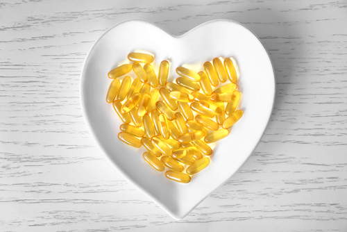 Omega-3 supplements in a bowl