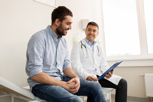 man talking to urologist