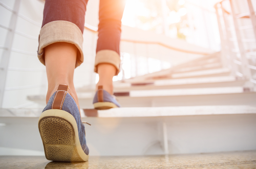 a girl climbing up the stairs