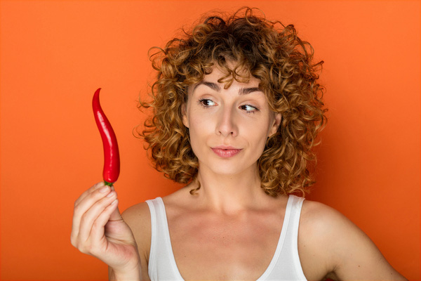 Lady holding red chilli