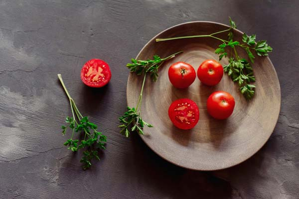 Tomatoes on a wooden plate