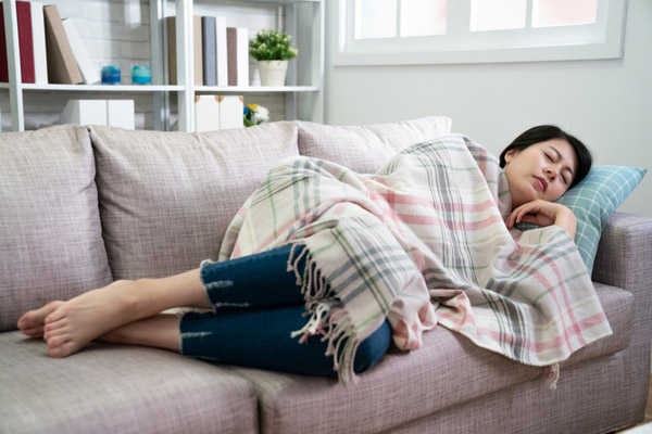 woman taking rest on couch