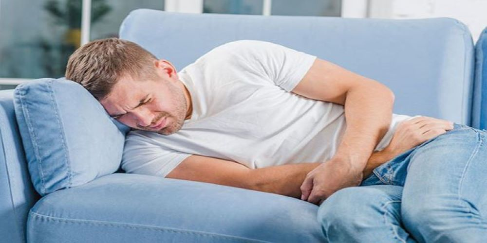 young man suffering from urinary infection