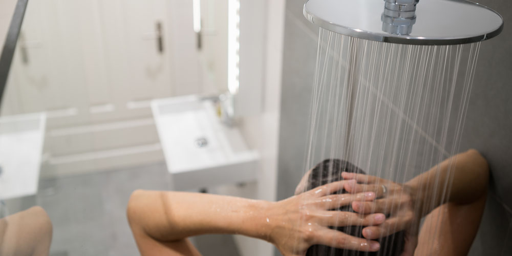 female taking a cold shower