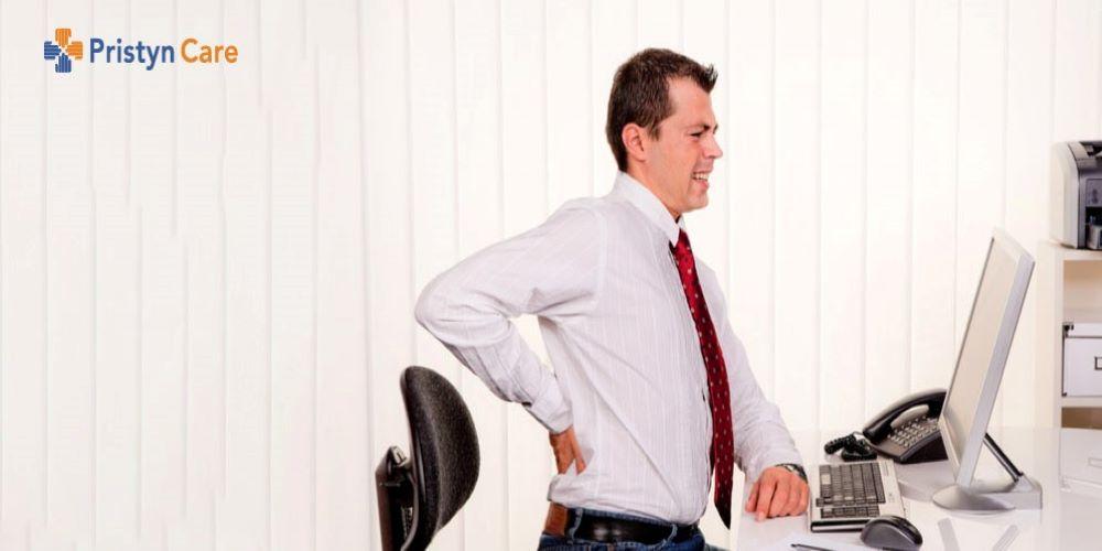 man suffering from pilonidal sinus pain