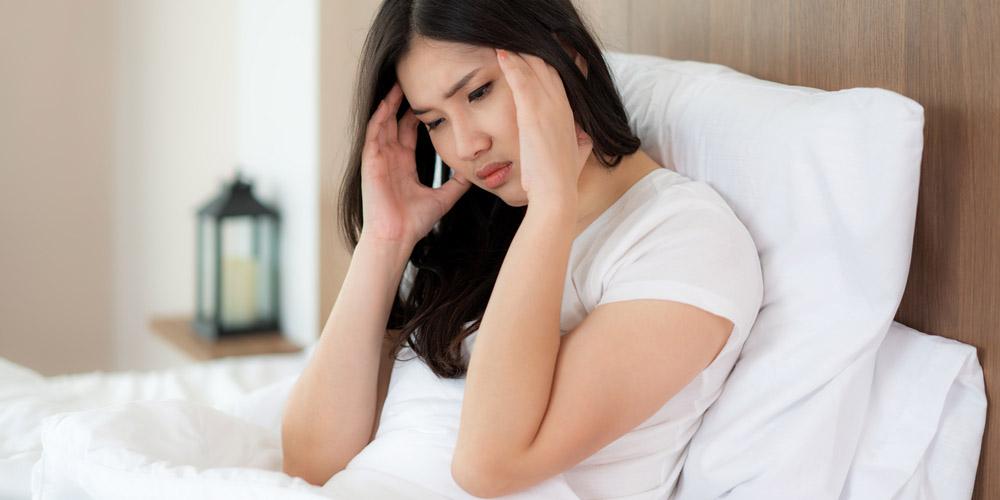 female having headache