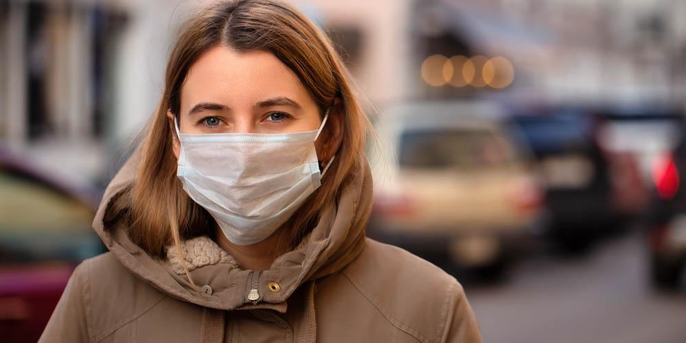 sick female wearing a mask