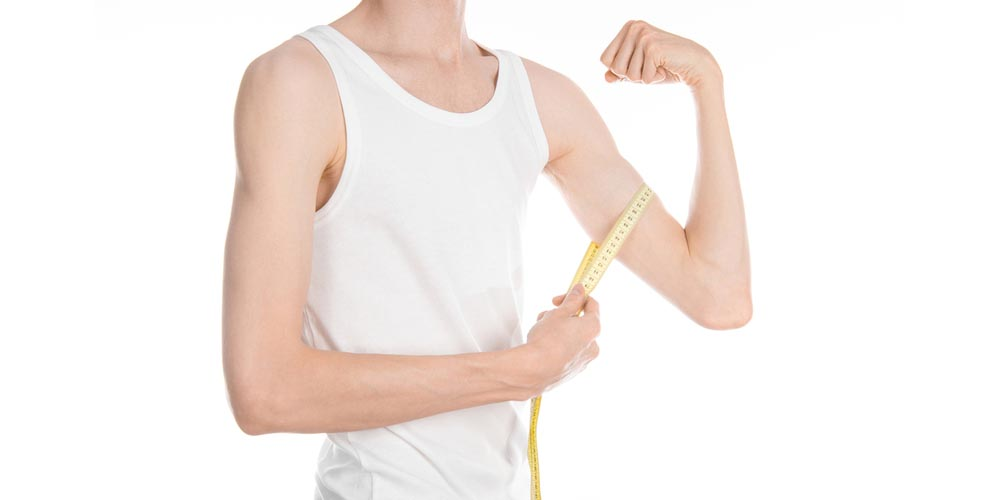 Man showing his weak muscles