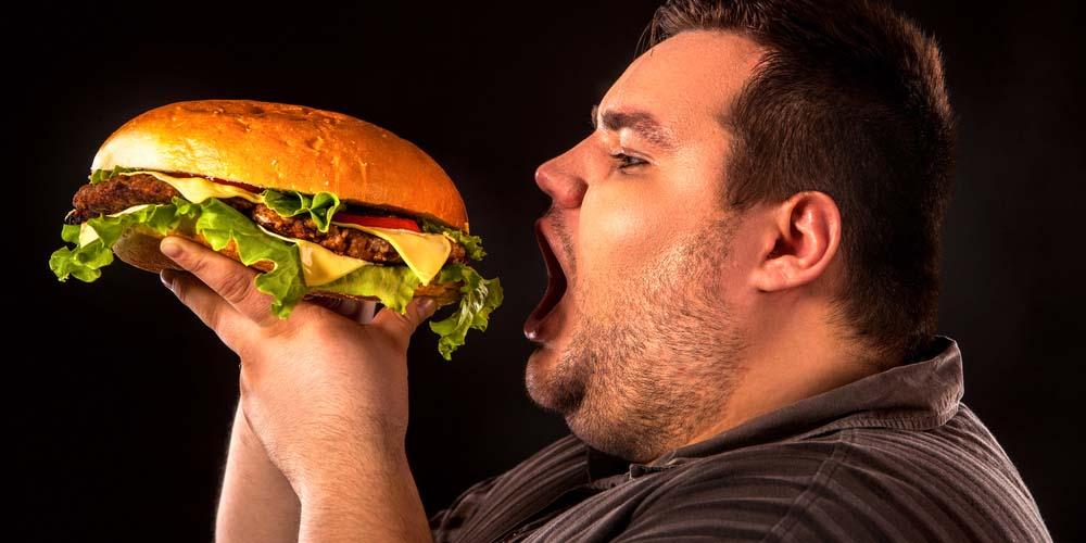 young man eating junk food