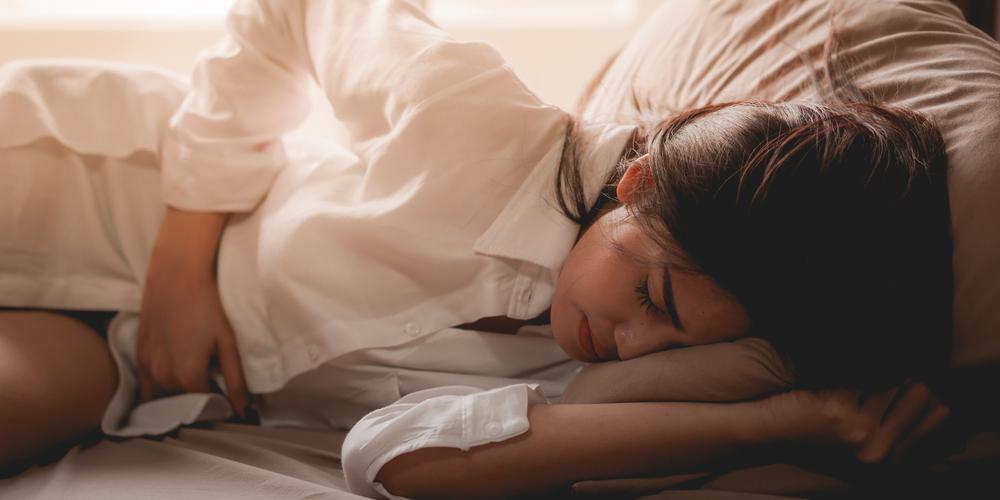 female having pain due to uterine fibroids