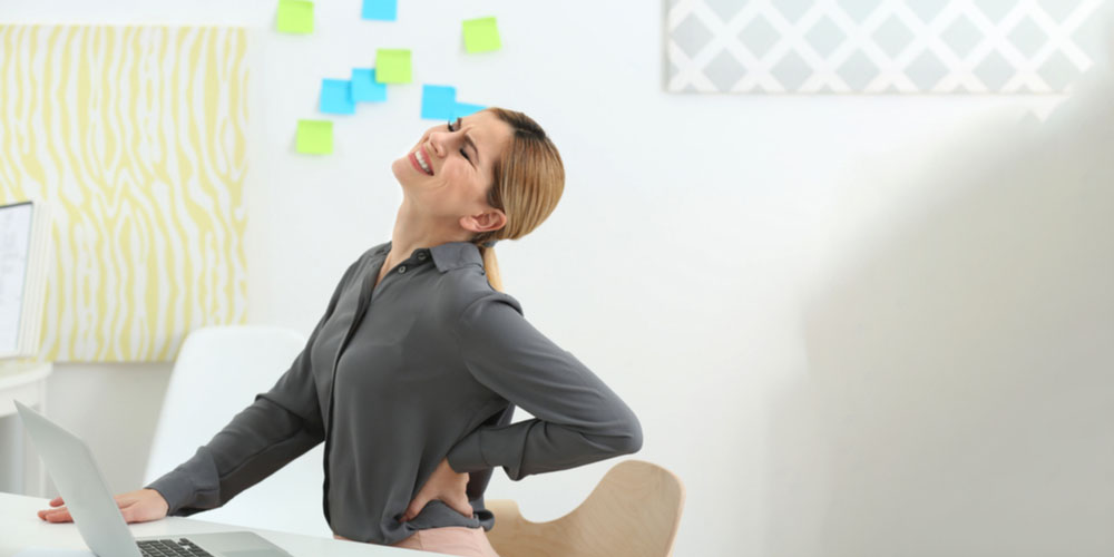 woman suffering from pilonidal sinus