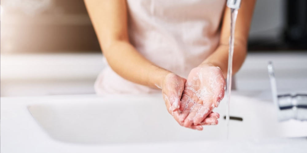 pregnant female washing hands
