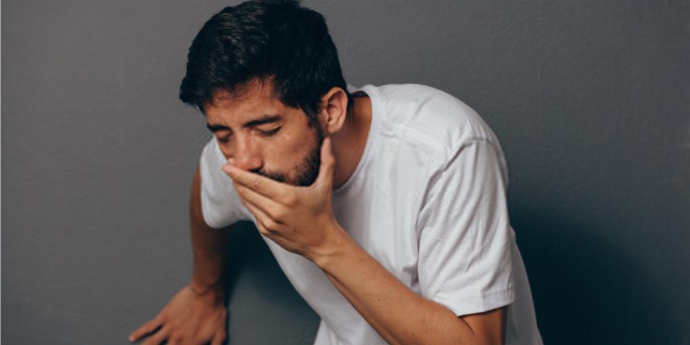 man feeling nausea-vomiting-side effects of hydrocele medicine
