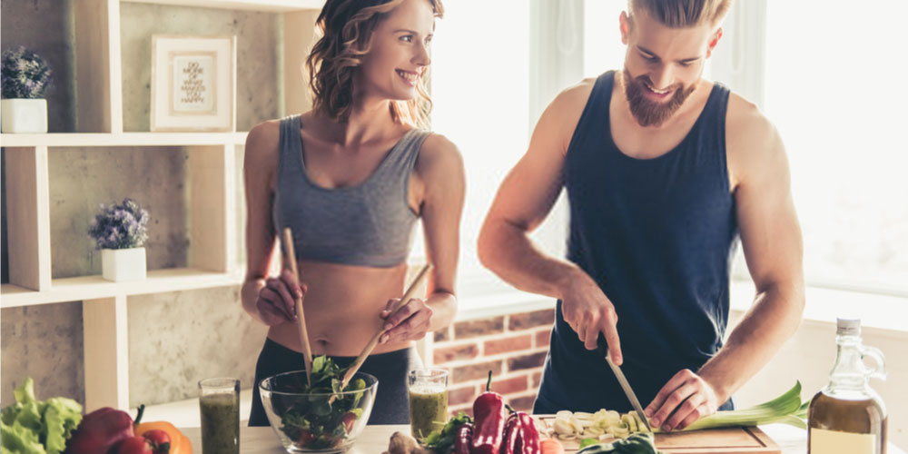 young couple cooking-healthy diet for erectile dysfunction